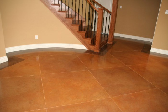 Residential Acid Stained Concrete floor with a border