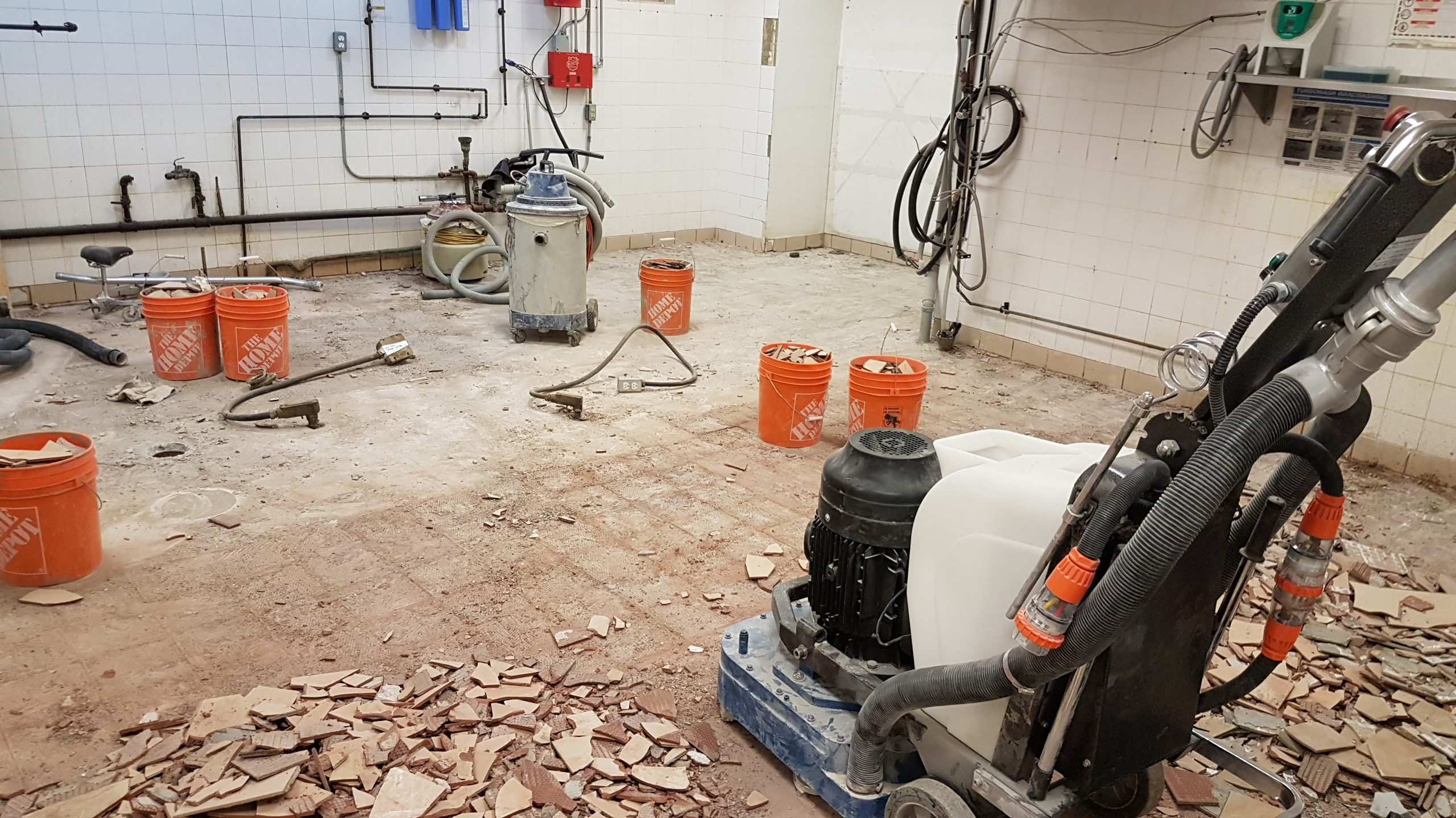 removing tile to prepare for new concrete flooring