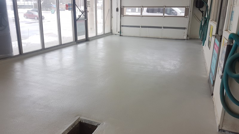 Concrete car wash flooring after